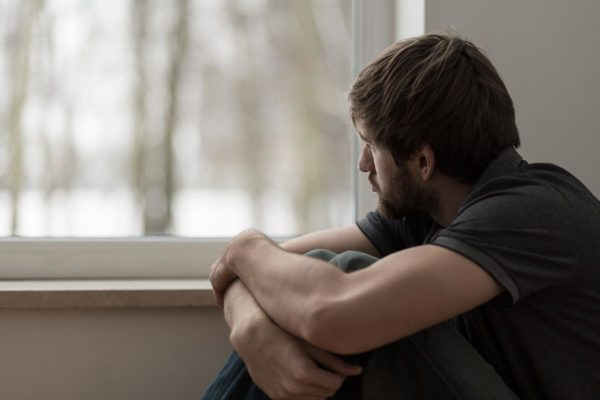 oceanfrontsoberliving-8-reasons-men-keep-their-depression-secret-article-photo-portrait-of-young-man-suffering-for-depression-272173868